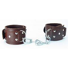 Коричневые кожаные оковы с клепками  Кожаные наручники потрясающего коричневого цвета.