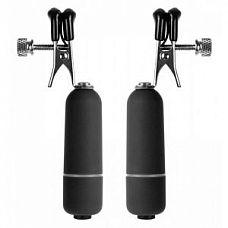 Чёрные клипсы на соски с вибрацией    Металлические зажимы для сосков с резиновым покрытием и вибрацией.