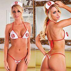 Комплект секси-медсестрички  Комплект медсестры с эмблемой HUSTLER в бело-красной расцветке, состоит из трех предметов: лиф, трусики-стринги и чепчик.