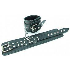 Чёрные наручники  из кожи с пряжкой   Кожаные наручники черного цвета.