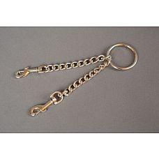 Цепь с центральным кольцом и карабинами по обе стороны - 15 см.  Цепь с центральным кольцом и двумя карабинами может использоваться для соединения наручников и поножей, а также других девайсов БДСМ-тематики.