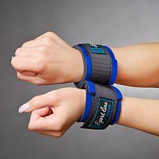 Чёрные наручники для начинающих с застежками на липучках   Наручники выполненные из современного материала - мягкого пенистого неопрена, ламинированного шелковистым спандексом, (относятся к классу Soft-bondage), прекрасный аксессуар для начинающих.