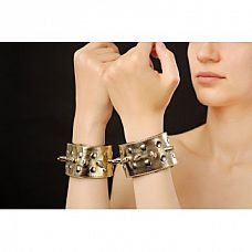 Напульсники для рук, Золотой  Украшения на руки в БДСМ-стиле - красивые напульсники из искусственной кожи, украшенные шипами и блестящим напылением.