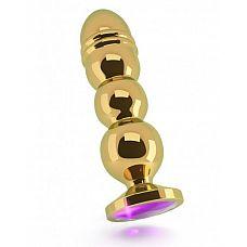 Золотистая фигурная анальная пробка R10 RICH Gold/Purple с фиолетовым кристаллом - 14,5 см.  Эта роскошная анальная пробка гарантирует Вам именно те ощущения от анальных игр, которые Вы хотите испытать! Эта специальная пробка имеет элегантный сглаженный дизайн с 3 стимулирующими шариками различного диаметра.