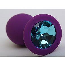 Фиолетовая силиконовая пробка с голубым стразом - 9,5 см.  Силиконовая анальная пробка с ограничительным основанием для безопасного использования.
