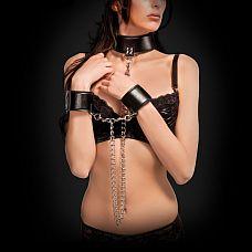 Чёрный двусторонний ошейник с наручниками Reversible Collar and Wrist Cuffs  Этот ошейник и наручники имеют полиуретановую и неопреновую стороны, и это позволяет вам выбирать касающийся вашей кожи материал простым выворачиванием ошейника или наручников на другую сторону.