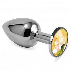 Серебристая анальная пробка с жёлтым кристаллом размера L - 9 см.  Серебристая анальная пробка с жёлтым кристаллом размера L.
