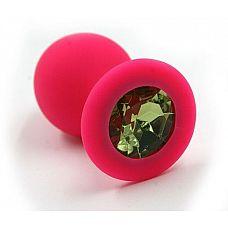 Розовая силиконовая анальная пробка с светло-зеленым кристаллом - 7 см.  Анальная пробка из силикона розового цвета, размер M.