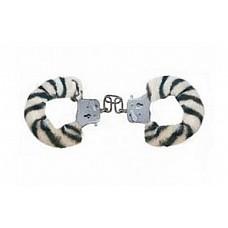 Меховые наручники с окраской под зебру (ToyJoy 9509)  Наручники металлические с синтетическим мехом c раскраской под зебру для ролевых игр. В комплекте два ключика.