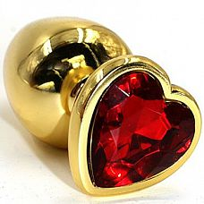 Золотистая анальная втулка с красным кристаллом-сердцем - 7 см.  Небольшая анальная втулка выполнена из металла и имеет размеры, подходящие для ношения и использования новичками.
