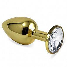 Золотистая анальная втулка с прозрачным кристаллом - 7 см.  Небольшая анальная втулка выполнена из металла и имеет размеры, подходящие для ношения и использования новичками.
