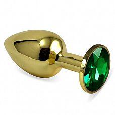 Золотистая анальная втулка с зеленым кристаллом - 7 см.  Небольшая анальная втулка выполнена из металла и имеет размеры, подходящие для ношения и использования новичками.