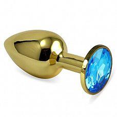 Золотистая анальная втулка с голубым кристаллом - 7 см.  Небольшая анальная втулка выполнена из металла и имеет размеры, подходящие для ношения и использования новичками.