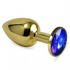 Золотистая анальная втулка с синим кристаллом - 7 см.  Небольшая анальная втулка выполнена из металла и имеет размеры, подходящие для ношения и использования новичками.