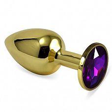 Золотистая анальная втулка с фиолетовым кристаллом - 7 см.  Небольшая анальная втулка выполнена из металла и имеет размеры, подходящие для ношения и использования новичками.