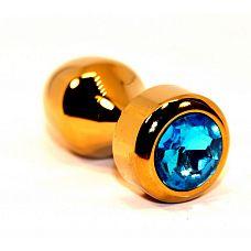 Золотистая анальная пробка с голубым кристаллом - 7,8 см.  Анальная пробка под золото с ярким кристаллом внесет разнообразие в вашу интимную жизнь.