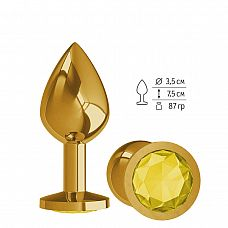 Золотистая средняя пробка с желтым кристаллом - 8,5 см.  Гладенькая металлическая пробка с кристаллом в ограничительном основании.