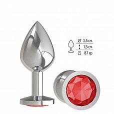 Серебристая средняя пробка с красным кристаллом - 8,5 см.   Гладенькая металлическая пробка с кристаллом в ограничительном основании.