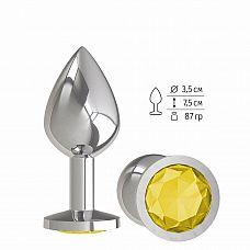Серебристая средняя пробка с желтым кристаллом - 8,5 см.  Гладенькая металлическая пробка с кристаллом в ограничительном основании.