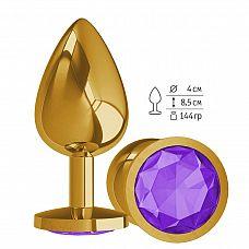 Золотистая большая анальная пробка с фиолетовым кристаллом - 9,5 см.  Гладенькая металлическая пробка с кристаллом в ограничительном основании.