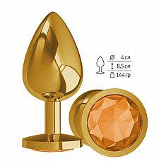 Золотистая большая анальная пробка с оранжевым кристаллом - 9,5 см.  Гладенькая металлическая пробка с кристаллом в ограничительном основании.