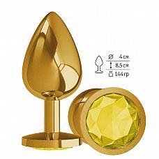 Золотистая большая анальная пробка с желтым кристаллом - 9,5 см.  Гладенькая металлическая пробка с кристаллом в ограничительном основании.