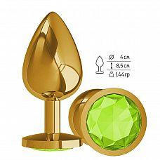 Золотистая большая анальная пробка с лаймовым кристаллом - 9,5 см.  Гладенькая металлическая пробка с кристаллом в ограничительном основании.