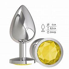 Серебристая большая анальная пробка с желтым кристаллом - 9,5 см.  Гладенькая металлическая пробка с кристаллом в ограничительном основании.