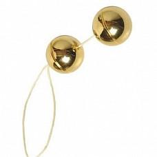 Шарики вагинальные золотые (Dream Toys 50482)  Золотые вагинальные шарики , со смещенным центром тяжести. Диаметр 3 см, для тренировки мышечной стенки влагалища.