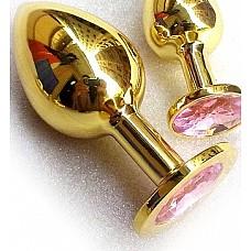 Золотая анальная пробка GOLDEN PLUG Large розовый  Золотая анальная пробка с шикарным розовым стразом на основании - это изящный способ разнообразить интимные моменты вашей близости и приятный подарок для партнера. Используется в качестве интимного украшения. Размер изделия L. Изготовлена из медицинской стали с позолотой. Длина 13 см, диаметр 4 см. Вес 300 гр.