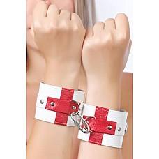 Наручники белые с красными крестами  Изготавливаются из натуральной кожи белого цвета с красными крестами и велюровой подкладкой.