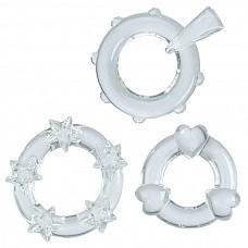 3 прозрачных эрекционных колечка MAGIC C-RINGS  Набор из 3 эротических колец. Качественные эрекционные аксессуары из прозрачного TPR. Диаметр колечка со звездами 3 см, с объемными точками и стимулятором клитора 2 см, с сердцами - 2 см. Рельефная форма предназначена для стимуляции обоих партнеров.