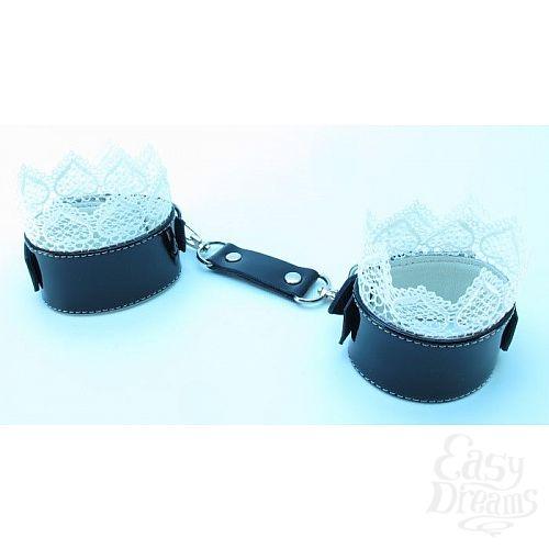 Фотография 1:  Изысканные чёрные наручники с белым кружевом