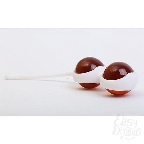 Фотография 1:  Коричневые вагинальные шарики в силиконовой оболочке
