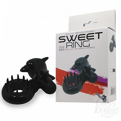 Фотография 1:  Чёрное эрекционное виброкольцо Sweet Ring с дельфинчиком
