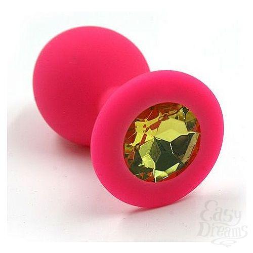 Фотография 1:  Розовая силиконовая анальная пробка с жёлтым кристаллом - 7 см.