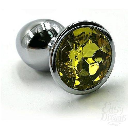 Фотография 1:  Серебристая алюминиевая анальная пробка с желтым кристаллом - 7 см.
