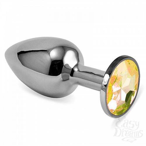 Фотография 1:  Серебристая анальная пробка с жёлтым кристаллом размера S - 7 см.