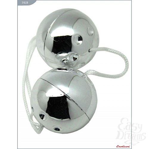 Фотография 1:  Серебристые шарики со смещённым центром тяжести